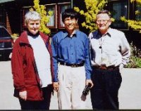 Principal Alison Rosanowski welcomes Rewi Alley Scholar Peng Dongjun and National President Bill Willmott to Darfield High School, sister school of the Shandan Bailie School, 5 November 2000.