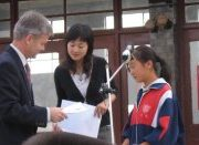 2005 NZCFS Silk Road tour leader, Royden Smith, presenting the scholarships on September 10, 2005.