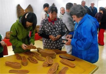 The author inspecting palm-frond products at Nanzheng Co-operative (which has been supported by NZCFS), Shaanxi province