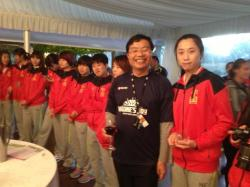 John Chen with the Chinese Women's Hockety Team.