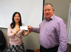 Miao Fan, Hamilton branch Co-President, presenting a cheque to Chris Goodwin, National Treasurer.