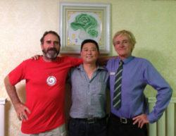 Brendan Corbett (left) with  a Shandan restaurateur and Jim (his predicesor)