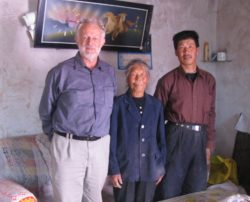 Dave Bromwich in Yongchang, Gansu province, with Chinese villagers. European features?