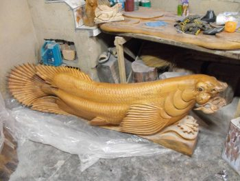 Carving of a mythical fish in camphor wood