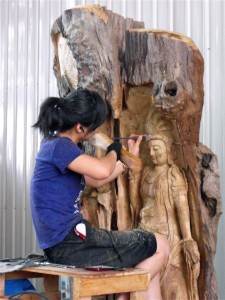 A female worker carving a Guan Yin