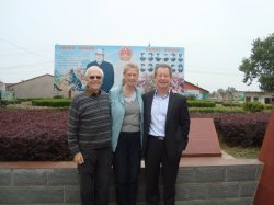 Three VICTour teachers in front of memorial to Li Xiannan, father of Mme Li Xiolin, Chairperson of CPAFFC