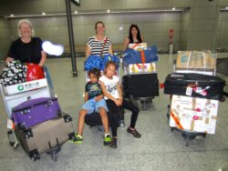Jan McLeod, Emily with family (Marcia, Rapanui and Takatea) arrive at Chengdu airport with 180kg of books for Cambridge Young Learners English School, Bazhong