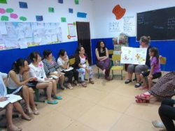 Emily, Kiwi English teacher, with daughters Marcia and Takatea, demonstrate a Big Book to Chinese English teachers at Cambridge Young Learners English School, Bazhong