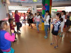 English teachers at Cambridge Young Learners English School, Bazhong, enjoy learning English action songs from Kiwi teacher, Emily and family (Takatea, L, and Rapanui)
