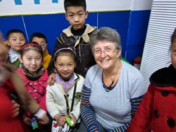 Rosy Look with pupils at Bazhong Primary School