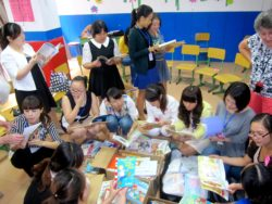 English teachers at Cambridge Young Learners English School, Bazhong, unpack Kiwi English books with Rosy Look (right)