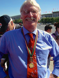 Dave Feickert with his 'Friend of China' medal, in front of the Great Hall of the People, Tiananmen Square, Beijing, October 2009