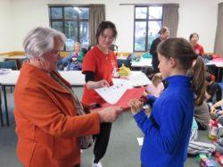 Gail Collingwood, with Gina, (Qianlan Zhou), awarding certificates