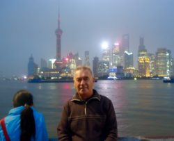 Bob Lawson in Shanghai, with Pudong business district in background