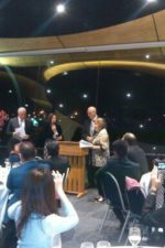 Christine Ward, to right of the lectern, receiving the award at the Sister City Awards Dinner