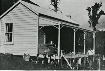 Rewi sitting on the verandah at Moeawatea in 1921 with Jack Stevens on  the right
